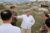 North Korea's leader Kim Jong Un has apologised to the South over the fatal shooting of a fisheries official earlier this week [File: KCNA via Reuters]