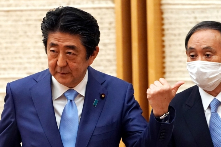 Abe's Chief Cabinet Secretary Suga Yoshihide, right, is likely to be a frontrunner in the race for the prime minister's office [File: Eugene Hoshiko/EPA]