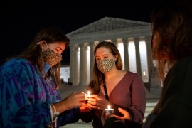 People light candles in front of the US Supreme Court in Washington, DC following the death of Justice Ruth Bader Ginsburg [Al Drago/Reuters]