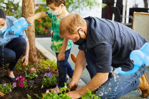 Prince Harry and Meghan Markle, the duke and duchess of Sussex, plant flowers and forget-me-nots during a visit to the Assistance League Los Angeles's Preschool Learning Center in Los Angeles, California, United States [File: Matt Sayles/Reuters]