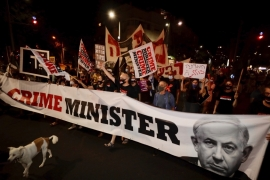 Israeli protesters hold signs and chant slogans during a demonstration against Israeli Prime Minister Benjamin Netanyahu In Tel Aviv on August 27, 2020 [File: AP/Sebastian Scheiner]
