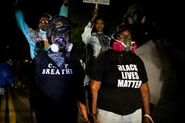 Protesters march following the release of video evidence that showed the death of Daniel Prude in police custody in the United States [File: Maranie R Staab/AFP]