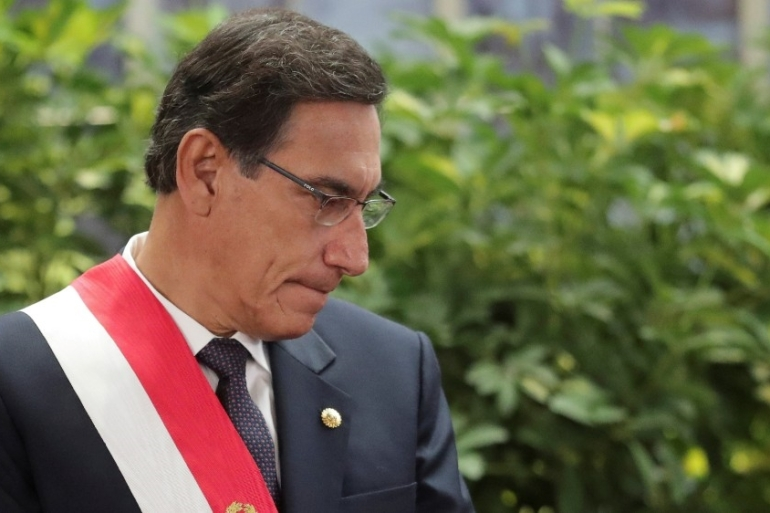Peru's former President Martin Vizcarra said he received a COVID-19 jab as a vaccine trial volunteer, but the head of the trial has since said Vizcarra was never a volunteer [File: Guadalupe Pardo/Reuters]