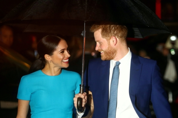The UK's Prince Harry and his wife Meghan, Duchess of Sussex, arrive at the Endeavour Fund Awards in London, UK in March [File: Hannah McKay/Reuters]