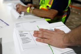 Poll workers prepare absentee ballots for shipment at the Wake County Board of Elections in Raleigh, North Carolina, U.S. September 4, 2020. [REUTERS/Jonathan Drake]