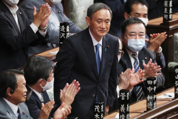 Japan's new Prime Minister Yoshihide Suga wants to repair frayed ties with neighbour South Korea [Koji Sasahara/AP Photo]