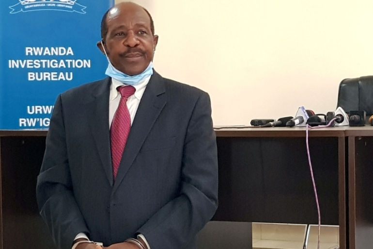 Rusesabagina was paraded last week in front of media in handcuffs at the Kigali headquarters of the Rwanda Investigation Bureau [Clement Uwiringiyimana/Reuters]