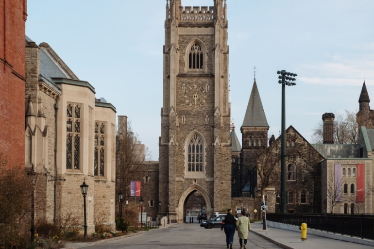 Pedestrians walk through the University of Toronto campus in this April 28, 2020 photo [Galit Rodan/Bloomberg]