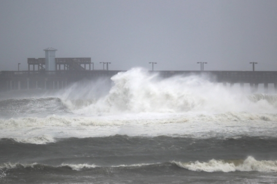 Waves break ashore near the Gulf State Park pier as the outer bands of Hurricane Sally come ashore [Joe Raedle/Getty Images/AFP]