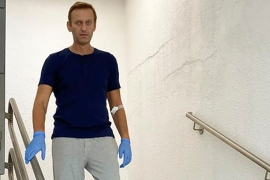 Russian opposition politician Alexey Navalny walks down stairs at Charite hospital in Berlin, Germany, in this image obtained from social media on September 19, 2020 [Courtesy of Instagram @NAVALNY/Social Media via Reuters]