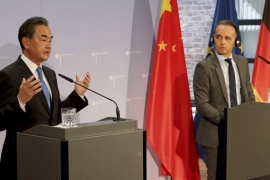 Maas, right, and Wang, left, hold a joint news conference after their meeting in Berlin [Michael Sohn/Pool/AP/Anadolu]