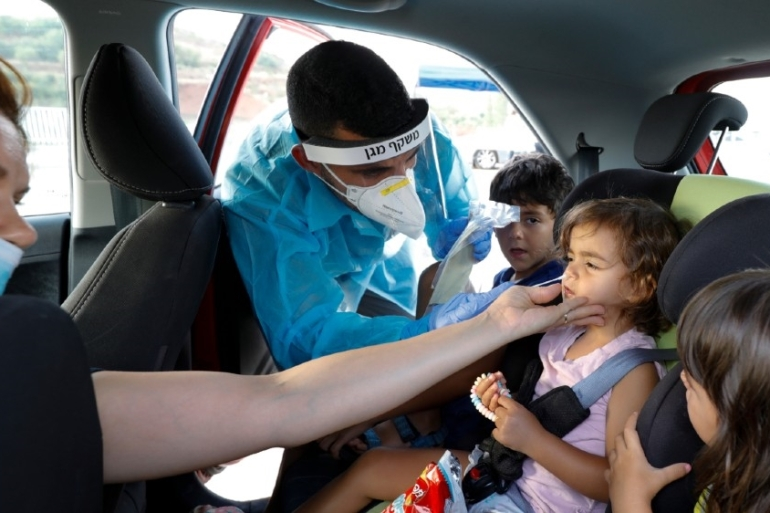Last week, the daily rate of new COVID-19 cases crossed 4,000 for the first time since the pandemic reached Israel [Jalaa Marey/AFP]