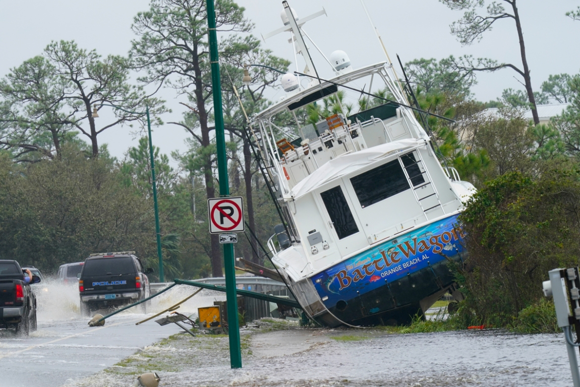 A boat is washed up near a road in Orange Beach. Several residents along the Alabama and Florida coasts said damage from the storm caught them off-guard. [Gerald Herbert/AP Photo]