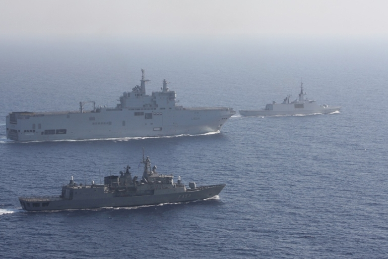 Greek and French vessels sail in formation during a joint military exercise in the Mediterranean sea, in this undated handout image obtained by Reuters on August 13, 2020 [Reuters]