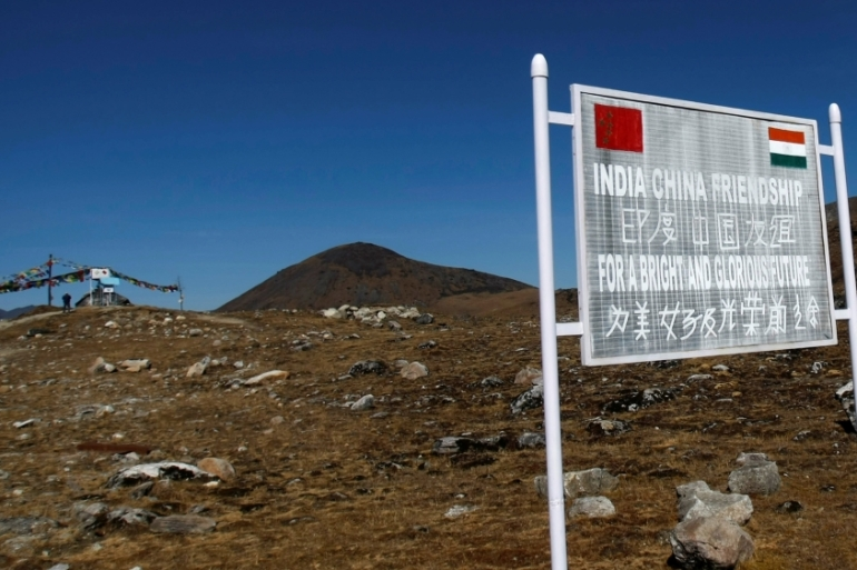 A signboard is seen from the Indian side of the India-China border at Bumla, in the northeastern Indian state of Arunachal Pradesh [File: Adnan Abidi/Reuters]