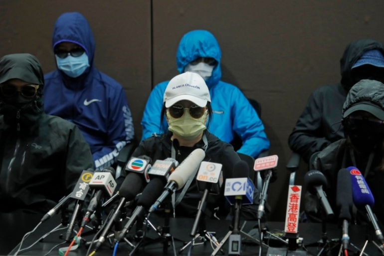 Relatives of 12 Hong Kong activists detained at sea by Chinese authorities call for their family members to be returned to the territory [Kin Cheung/AP Photo]