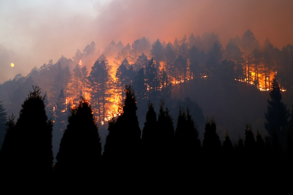 More than 1,000 firefighters have struggled to contain the flames. [John G Mabanglo/EPA]