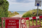 A road closure due to the cliff collapse in Happisburgh [Gaia Lamperti/Al Jazeera]