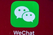 President Donald Trump has ordered a sweeping but unspecified ban on dealings with the Chinese owners of the consumer apps TikTok and WeChat, although it remains unclear if he has the legal authority to actually ban the apps from the United States [File: Mark Schiefelbein/AP Photo]
