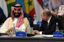 Saudi Arabia's Crown Prince Mohammed bin Salman, left, attends the G20 Leaders' Summit in Buenos Aires with Russia's President Vladimir Putin in 2018 [Alejandro Pagni/AFP]