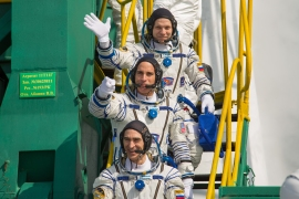 NASA astronaut Chris Cassidy and Russian cosmonauts Anatoly Ivanishin and Ivan Vagner, members of the International Space Station board the Soyuz MS-16 spacecraft [File: Russian Space Agency Roscosmos via AFP]