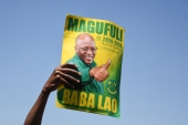 If re-elected, Magufuli is promising to continue his crackdown on corruption and end government waste [Ericky Boniphace/AFP]