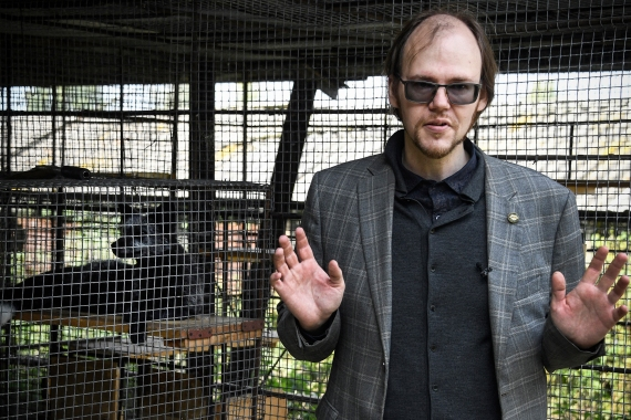 "This artificial selection ""changes everything in their body"", said Yuri Gerbek, 36, chief specialist at the Belyayev fox facility. [Alexander Nemenov/AFP]"