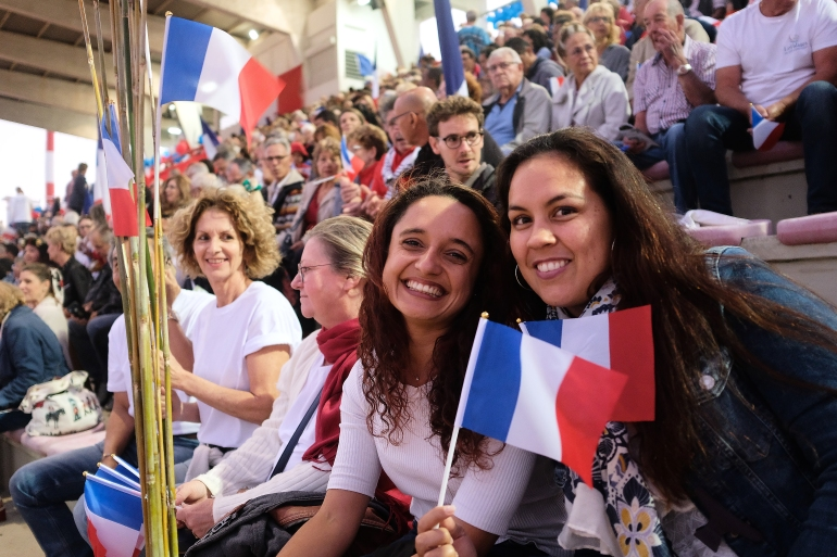 People wave French national flags during the last meeting of the loyalists for the 'no' to the self-determination referendum of New Caledonia, in Noumea on October 1, 2020 [Theo Rouby/AFP]