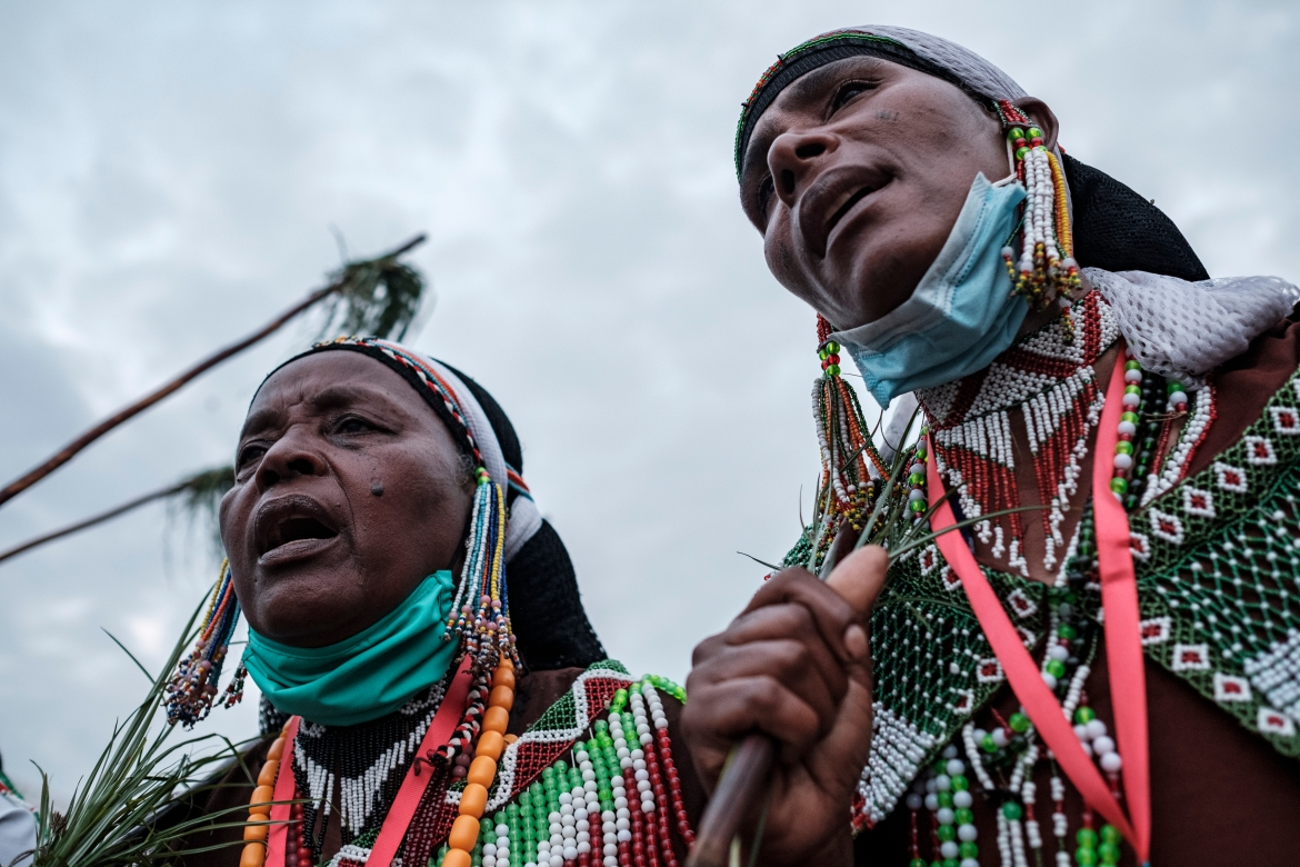 Women, wearing traditional clothing, sing and march during the celebration of Irreechaa, the Oromo people thanksgiving holiday, in Addis Ababa. [Eduardo Soteras/AFP]