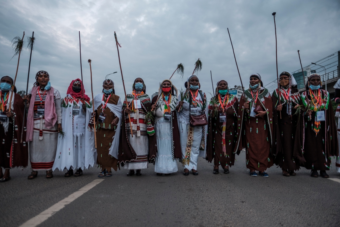 Men in traditional clothing during the celebration of Irreechaa. [Eduardo Soteras/AFP]