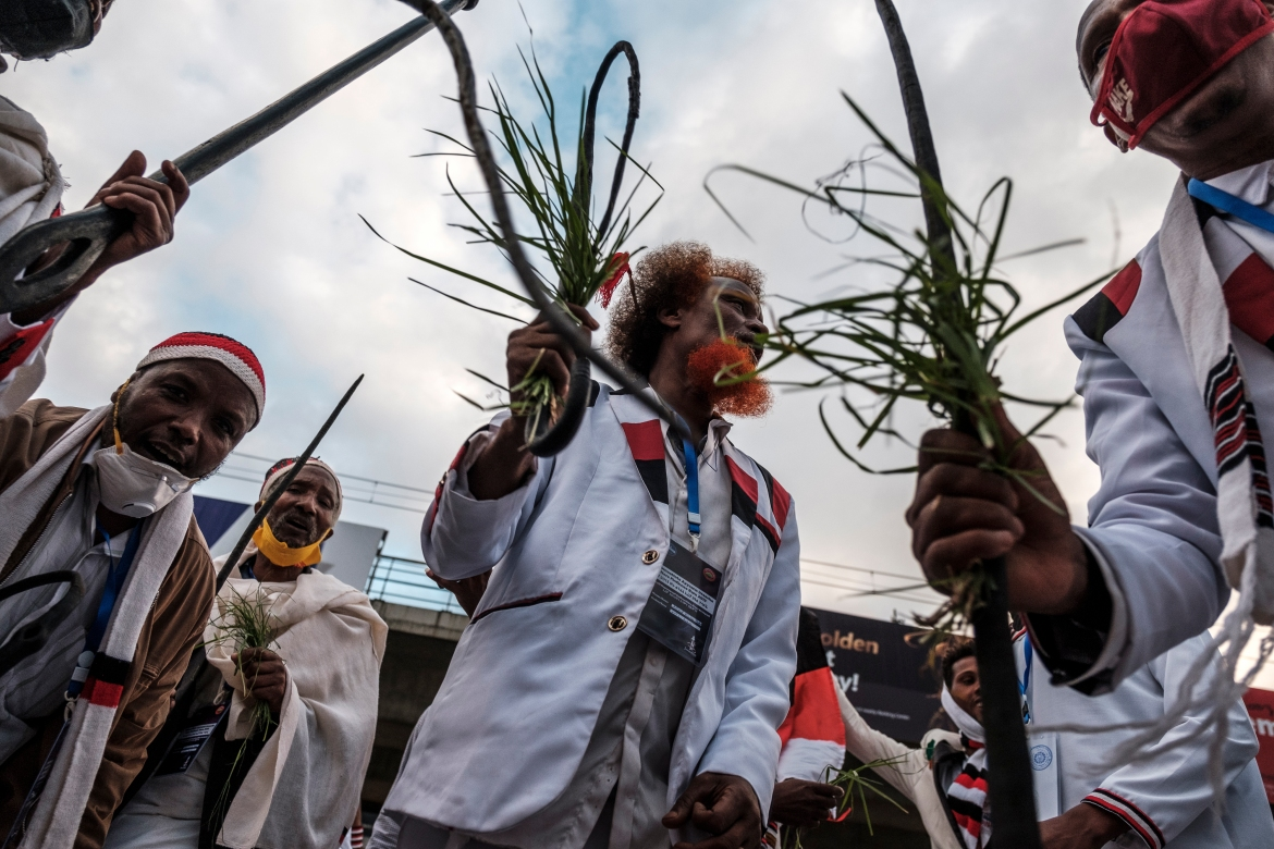 A small crowd led by chanting Oromo traditional leaders gathered at pools of water in central Addis Ababa. [Eduardo Soteras/AFP]