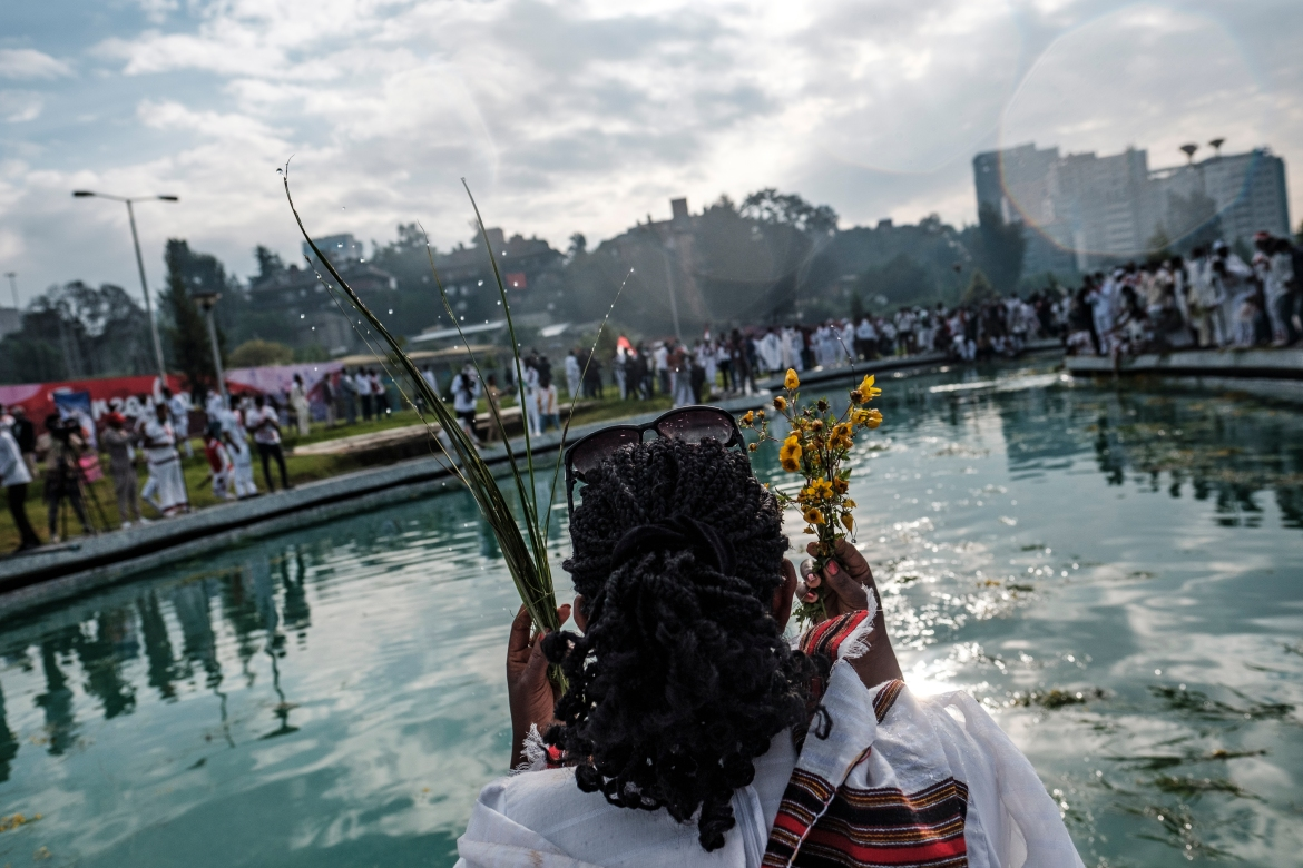Celebrants dipped flowers in water and sprinkled it over themselves, gestures symbolising gratitude and renewal. [Eduardo Soteras/AFP]