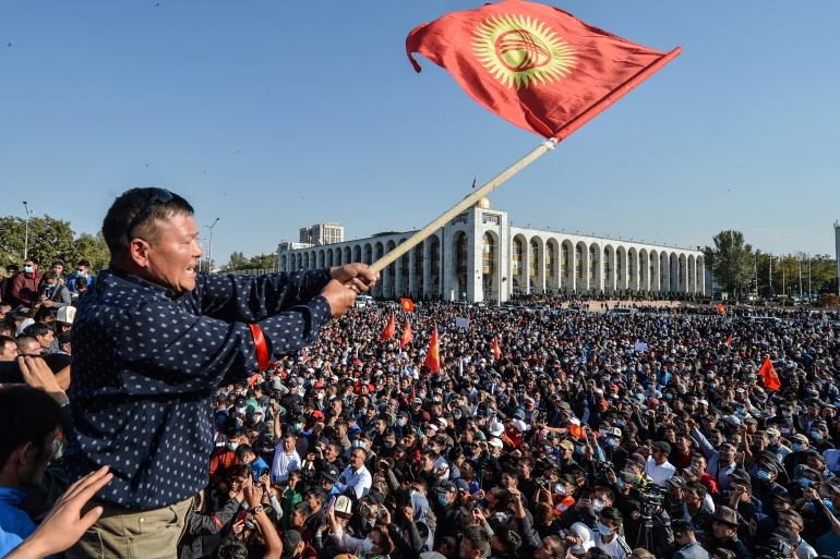 People protest against the results of a parliamentary vote in Bishkek [Vyacheslav Oseledko/AFP]