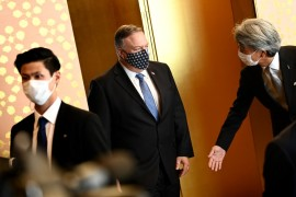 Pompeo (centre) arrives to attend a meeting with Japan's foreign minister (not pictured) in Tokyo on Tuesday [Charly Triballeau/AFP]