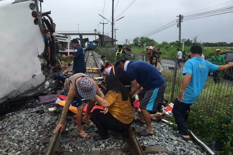 Early images by rescue workers showed gnarled metal and debris, with bodies lying by the train tracks and people's belongings scattered [Bangpakong Rescue Foundation via AFP]