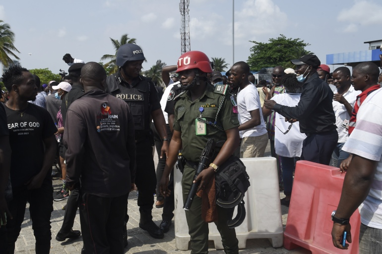 Nigerians demanding an end to police brutality have been protesting for nearly two weeks across the country [File: Pius Utomi Ekpei/AFP]