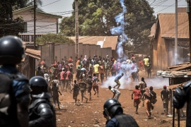 Police throw rocks and fire tear gas at protesters in the opposition stronghold of Wanindara, a northern suburb of Conakry, Guinea [File: Cellou Binani/AFP]