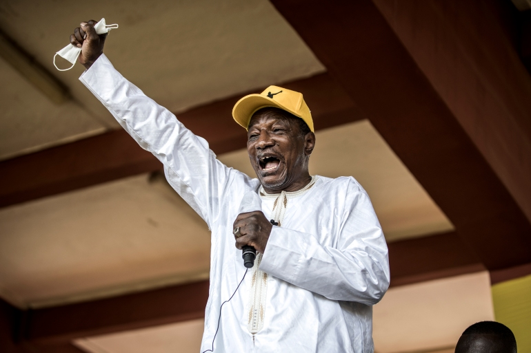President Alpha Conde, 82, is hoping for a third term in office [John Wessels/AFP]