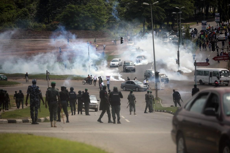 Nigerian police fire teargas at protesters on the Abuja-Keffi Expressway, Abuja. [Kola Sulaimon/AFP]