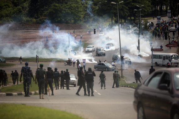 Nigerian police fire teargas at protesters on the Abuja-Keffi Expressway, Abuja. [Kola Sulaimon/AFP]
