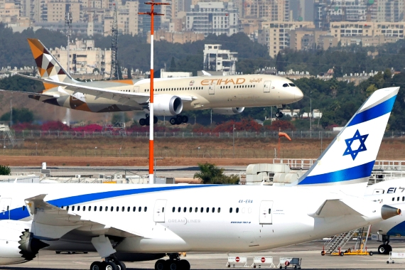 An Etihad Airways plane carrying a delegation from the UAE on a first official visit, lands at at Israel's Ben Gurion Airport [Jack Guez/AFP]