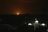 Flames are seen following an Israeli air attack in the town of Deir al-Balah in the central Gaza Strip [Said Khatib/AFP]
