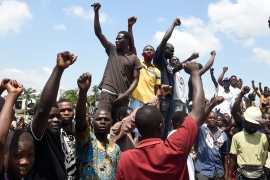 Protesters chant and sing solidarity songs as they barricade the Lagos-Ibadan expressway to protest against police brutality [Pius Utomi Ekpei/AFP]