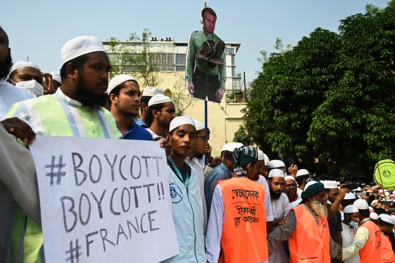 Activists and supporters of the Islami Andolon Bangladesh party march in Dhaka calling for boycott of French products [Munir Uz Zaman/AFP]