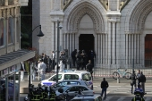 French members of the elite tactical police unit RAID search the Basilica of Notre-Dame de Nice after a knife attack [Valery Hache/AFP]
