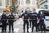 Police block access to the Notre-Dame de l'Assomption Basilica in Nice [Valery Hache/AFP]