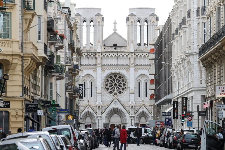 Police block the access to the Notre-Dame de l'Assomption Basilica in Nice on October 29, 2020 after a knife-wielding man kills three people at the church [Valery Hache/Al Jazeera]