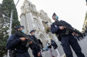 Police officers stand guard by the Notre-Dame de l'Assomption Basilica in Nice after Thursday's attack [Eric Gaillard/AFP]