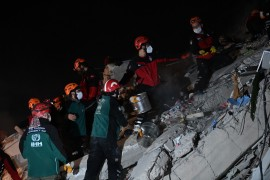 Rescuers search through the night on Friday and early Saturday for survivors among the rubble of a collapsed building after a powerful earthquake struck Turkey's western coast and parts of Greece [Ozan Kose/AFP]