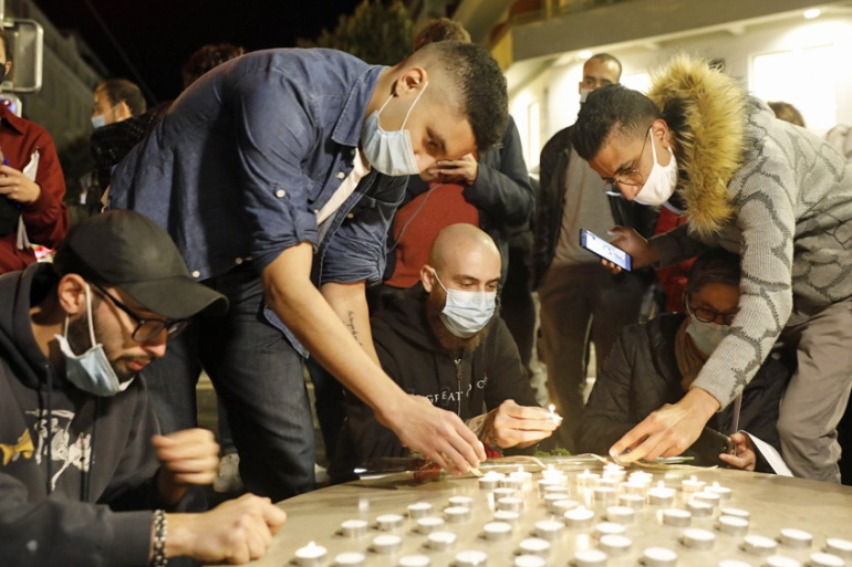 Candles were lit near the entrance of the Notre Dame Basilica church in Nice following the knife attack [Sebastien Nogier/EPA]
